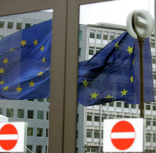 The EU nations flags are mirrored in the windows of the EU Council headquarters ahead of a two-day EU summit in Brussels, Wednesday March 12, 2008