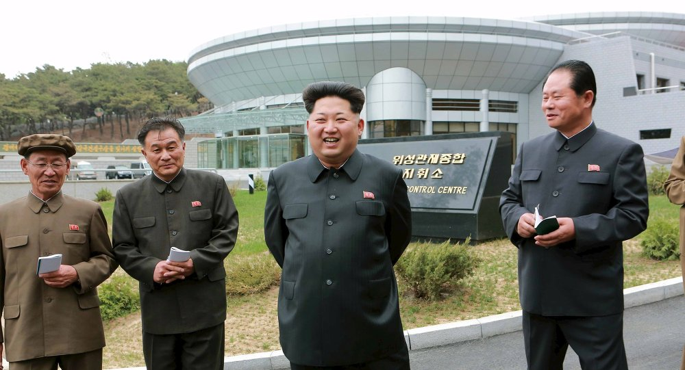 North Korean leader Kim Jong Un (2nd R) provides field guidance at the newly built National Space Development General Satellite Control and Command Centre in this undated photo released by North Korea's Korean Central News Agency (KCNA) in Pyongyang May 3, 2015.