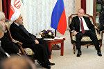 Президент России Владимир Путин (справа) и президент Исламской Республики Иран Хасан Роухани, фото из архива