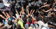 Protesters against a hike in electricity prices scuffle with policemen in Yerevan, Armenia, July 6, 2015.