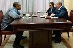 Boksçu Roy Cons və Rusiya prezidenti Vladimir Putin
