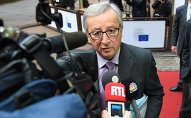 European Commission President Jean-Claude Juncker addresses reporters as he arrives to attend a Eurogroup finance ministers meeting at the European Council in Brussels, on January 26, 2015