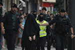 Spanish police arrest an 18-year-old Moroccan woman suspected of recruiting other women via the Internet to the jihadist group Islamic State (IS), in Gandia on September 5, 2015.