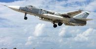 Российский самолет Су-24 взлетает с авиабазы Хмеймим в Сирии