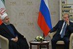 İran prezidenti Həsən Ruhani və Rusiya prezidenti Vladimir Putin. arxiv şəkli