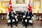Ahmet Davutoğlunun Devid Kameronla görüşü