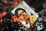 Портрет Муамара Каддафи в огне