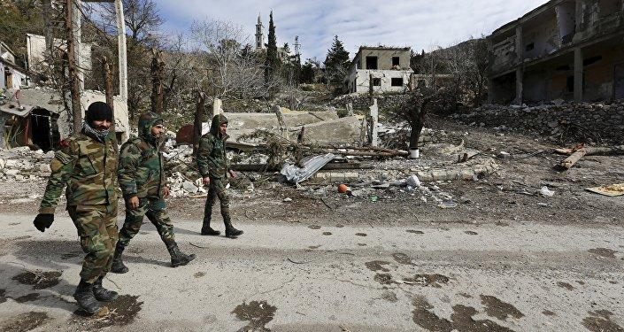 Разрушенные здание в сирийском городе Рабия
