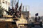 Rakka şəhərində İŞİD döyüşçüləri. Arxiv şəkli