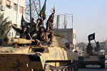 Боевики ИГ в Сирии. Архивное фото