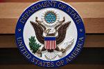 Символ Государственного департамента США в зале для брифингов. Архивное фото
