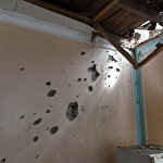 Evin divarındakı artilleriya atəşinin izləri