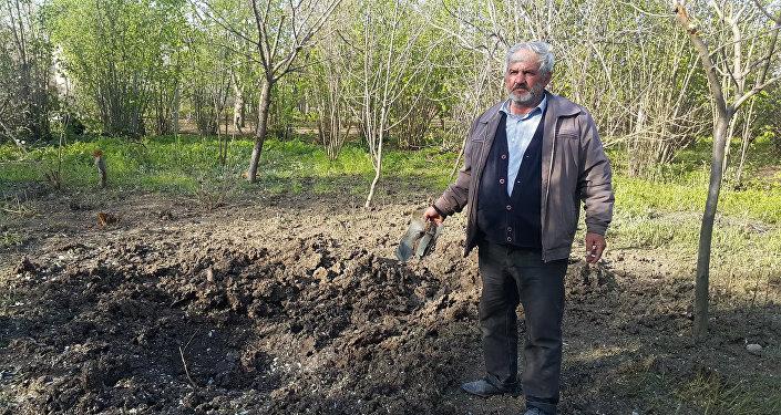По словам жителя села Сардара Гараева, снаряды, брошенные армянскими боевиками, разрушили и посевные участки