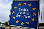 Ein Schild mit der Überschrift Bundesrepublik Deutschland an der Autobahn bei Aachen