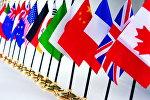 Настольные флаги стран. Архивное фото