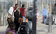 Сирийские беженцы в аэропорту Ганновера. Архивное фото