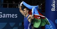 Теймур Мамедов празднует свою победу на I Европейских играх в Баку. 25 июня 2015 года