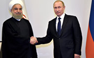 Встреча президентов России и Ирана Владимира Путина и Хасана Роухани. Баку, 8 августа 2016 года