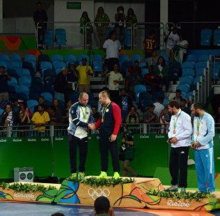 Медалисты Олимпиады в соревнованиях по вольной борьбе среди мужчин в весовой категории до 97 кг