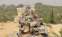 Танки ВС Турции продвигаются в направлении города Джераблус вблизи турецко-сирийской границы. 24 августа 2016 года