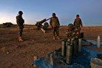 Бойцы курдского ополчения (пешмерга) готовятся к операции по освобождению Мосула в Ираке
