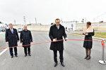 Президент Азербайджана Ильхам Алиев принял участие в открытии в Сабунчинском районе Баку капитально реконструированной автомобильной дороги Рамана-Маштага и пятикилометрового участка автодороги Зых-Амирджан-Ени Сураханы
