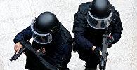 Сотрудники правоохранительных органов во время спецоперации, фото из архива