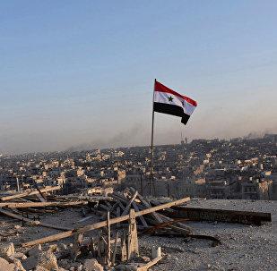 Hələbin şərq hissəsində dalğalanan Suriya bayrağı, 11 dekabr 2016-cı il
