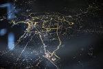 Вид ночного города Баку с самолета