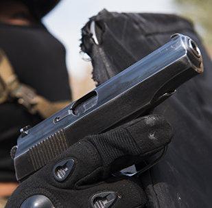 Пистолет в руке, фото из архива