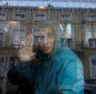 Мигрант из Афганистана во Франции, фото из архива