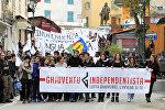 Корсиканские националисты в ходе демонстрации на улицах Корте, Северная Корсика, 3 декабря 2014 года