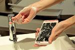 Qab yuyan vasitə ilə yuyulan mobil telefon