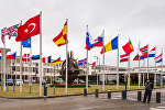 Флаги стран НАТО перед штаб-квартирой Альянса в Брюсселе