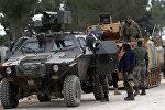 Члены ВС Турции и Свободной армии Сирии в деревне Аль-База недалеко от города Аль-Баб в Сирии, 4 февраля 2017 года