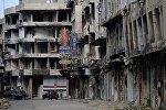 Разрушенные дома на одной из улиц Хомса
