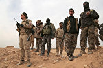 Боевики Демократических сил Сирии в окрестностях города Ракка, фото из архива
