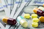 Лекарства на деньгах, фото из архива