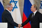 İsrailin Baş naziri Benyamin Netanyahunun Rusiya prezidenti Vladimir Putinlə, arxiv şəkli