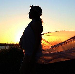 Беременная женщина, фото из архива
