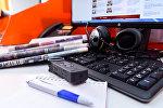 Газеты на компьютерной клавиатуре, фото из архива