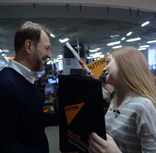 Руководитель Sputnik в странах СНГ и Балтии Андрей Благодыренко и Анастасия Кравченя