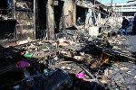Последствия пожара на знаменитом рынке Тезе базар в Баку