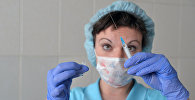 Медсестра в детской поликлинике, фото из архива