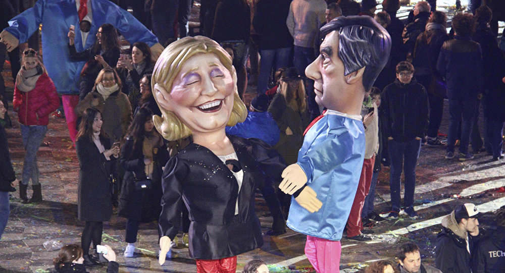 Куклы французских кандидатов в президенты Марин Ле Пен, слева и Франсуа Фийон, фото из архива