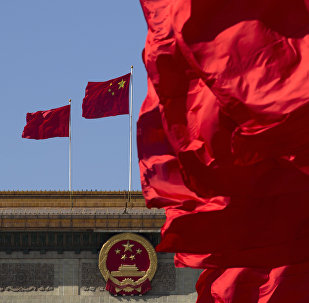 Флаги Китая на здании Дома народных собраний в Пекине, фото из архива