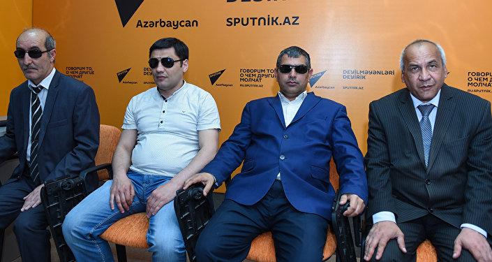 Инвалиды по зрению Фамиль Гаджиев, Анар Омаров, Фаиг Тагиев и Вафадар Новрузов
