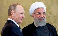 Президент РФ Владимир Путин и президент Исламской Республики Иран Хасан Рухани (справа), фото из архива