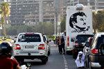 Картина с изображением 4-го эмира Катара Тамима бин Хамада Аль Тани во время демонстрации в его поддержку в Дохе, Катар, 11 июня 2017 года