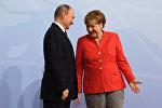 Almaniya kansleri Angela Merkel və Vladimir Putin